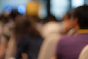 abstrait flou fond de personnes dans la salle de réunion. photo
