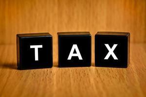 Texte de comptabilité fiscale sur bloc photo
