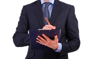 homme d'affaires, rédaction de notes sur le presse-papiers. photo