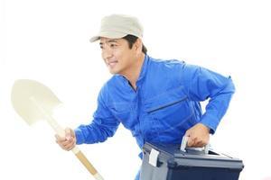 travailleur asiatique souriant photo