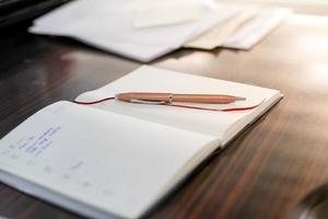 stylo dans le planificateur photo
