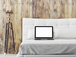 maquette d'ordinateur portable sur le lit, illustration 3d photo