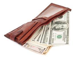 portefeuille avec dollars photo