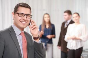 homme d'affaires avec une équipe lors de la réunion photo
