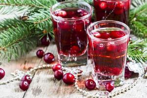boisson aux canneberges sur fond de Noël