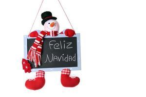 Feliz Navidad écrit sur le tableau de Noël bonhomme de neige photo