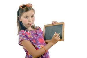 écolière avec une ardoise photo