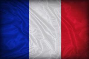 Drapeau de la France sur la texture du tissu, style vintage photo