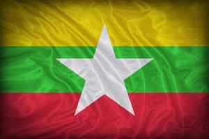 Modèle de drapeau du myanmar sur la texture du tissu, style vintage photo