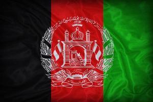 Modèle de drapeau de l'Afghanistan sur la texture du tissu, style vintage photo