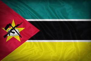 Drapeau du Mozambique sur la texture du tissu, style vintage photo