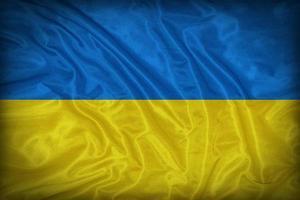 Drapeau ukrainien sur la texture du tissu, style vintage photo