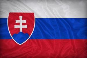 Drapeau de la Slovaquie sur la texture du tissu, style vintage