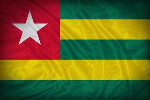 Drapeau du Togo sur la texture du tissu, style vintage photo
