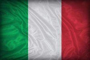 Modèle de drapeau de l'Italie sur la texture du tissu, style vintage photo