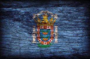 Modèle de drapeau de Melila sur la texture de la planche de bois, style vintage rétro photo
