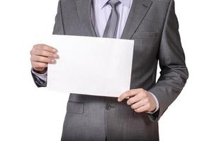 homme d'affaires détenant une pancarte blanche