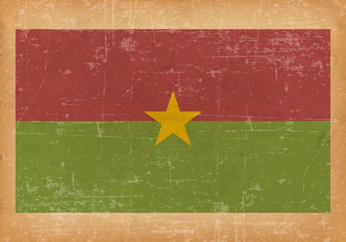 Drapeau du Burkina Faso sur fond grunge vecteur