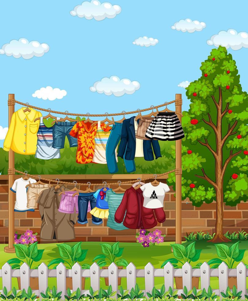 de nombreux vêtements suspendus à une ligne à l'extérieur de la scène de la maison vecteur