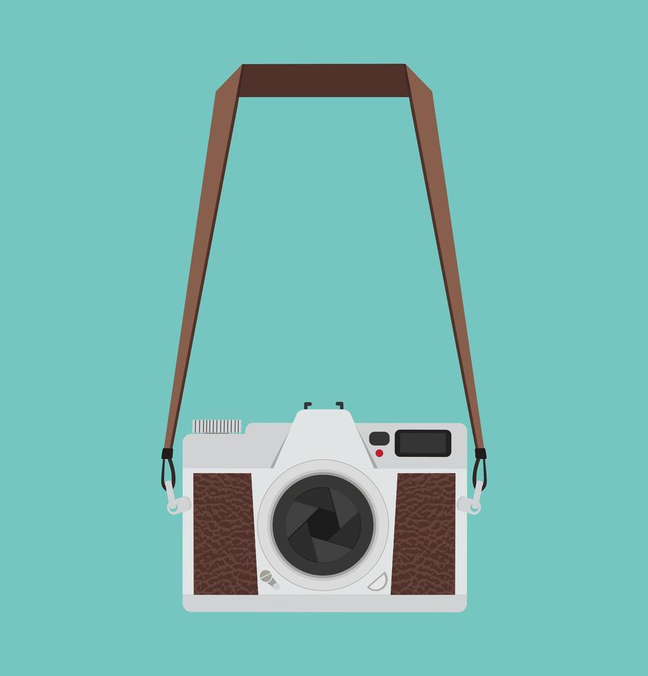 appareil photo vintage de style plat accroché sur un fond vert vecteur