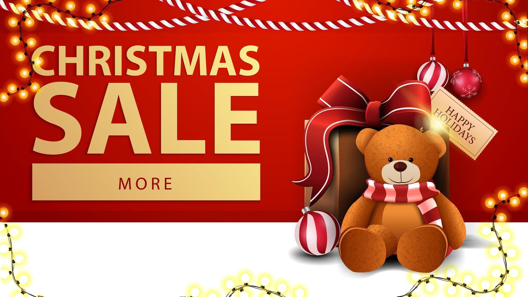 vente de noël, bannière de réduction rouge avec guirlandes, bouton et cadeau avec ours en peluche près du mur vecteur