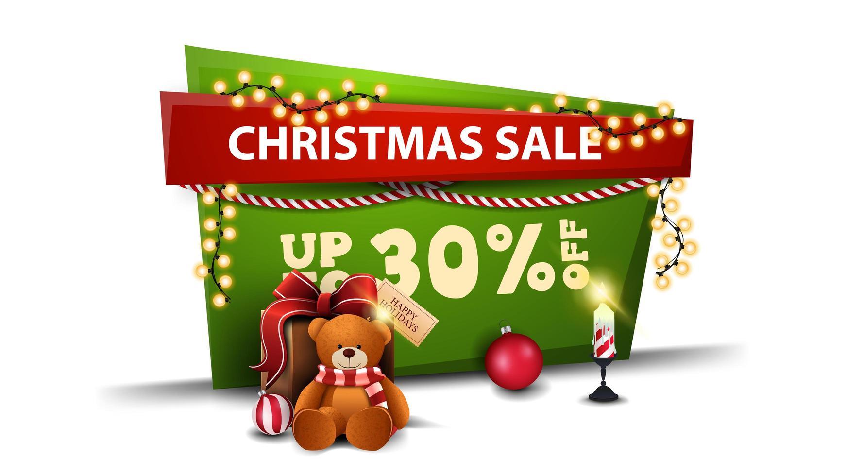 vente de Noël, jusqu'à 30 de réduction, bannière de réduction verte et rouge en style cartoon avec guirlande et cadeau avec ours en peluche vecteur