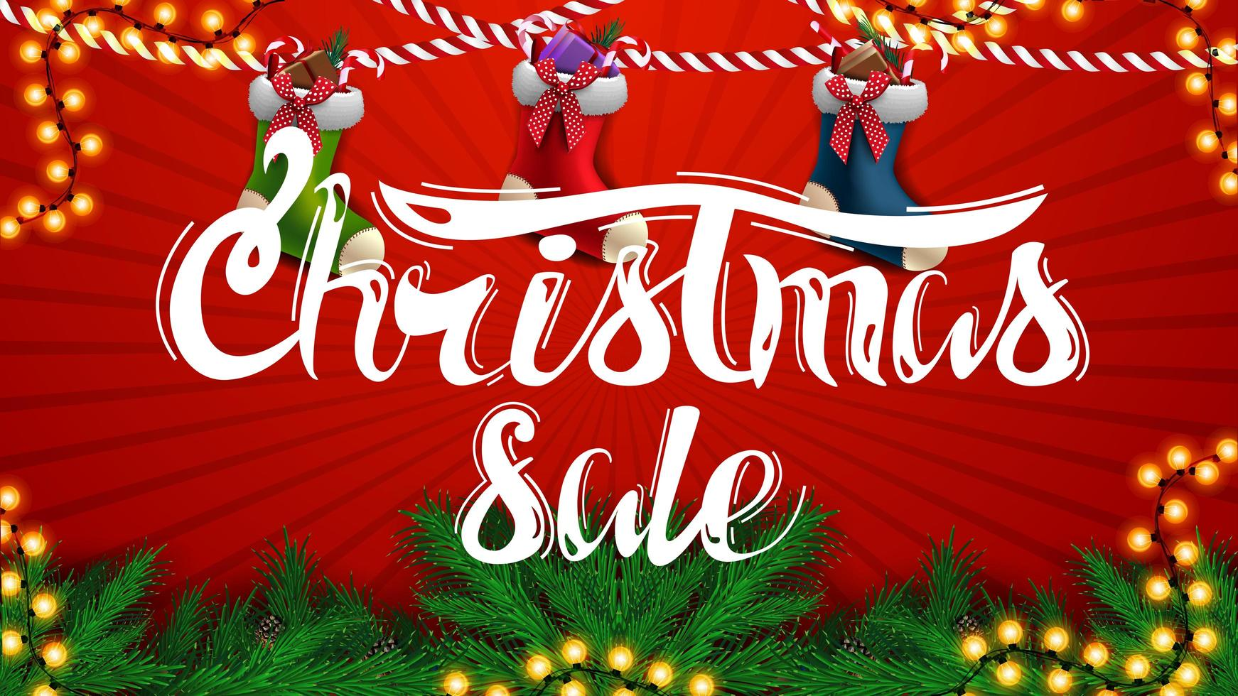 vente de noël, belle bannière de réduction rouge avec des branches d'arbres de noël, des guirlandes et des bas de noël vecteur