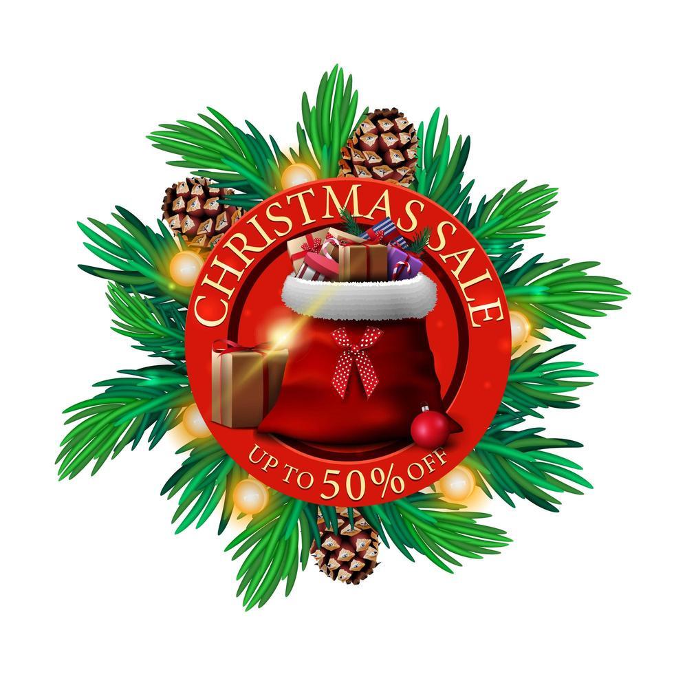 vente de Noël, jusqu'à 50 rabais, bannière de réduction ronde avec des branches d'arbre de Noël et sac du père Noël avec des cadeaux vecteur