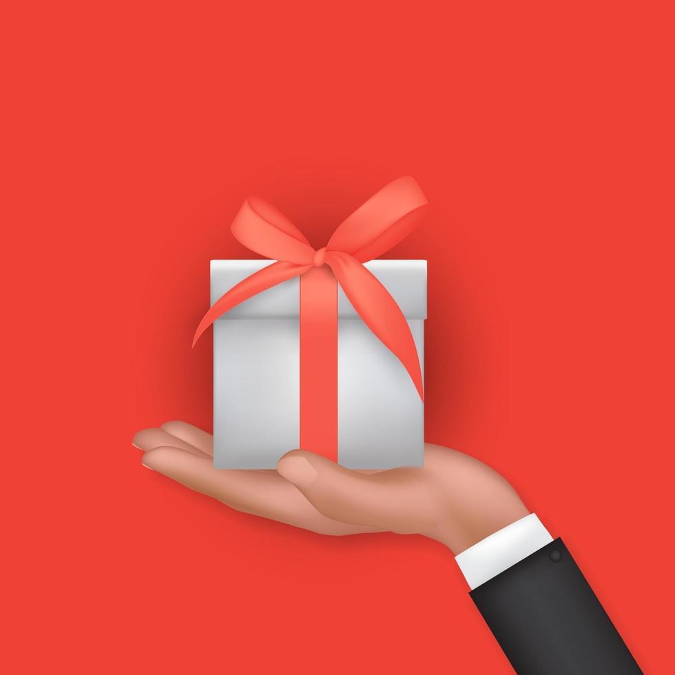 main 3d réaliste tenant une boîte-cadeau avec un arc et un ruban sur fond rouge vecteur