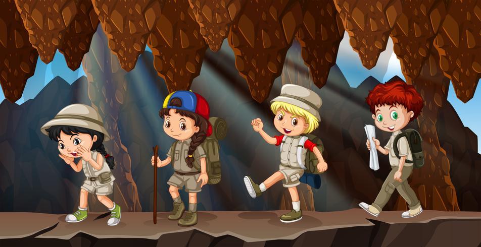 Un groupe d'enfants en randonnée dans la grotte vecteur