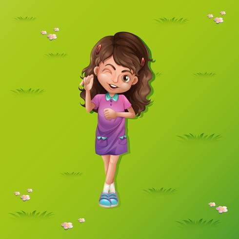 Jolie fille sur l'herbe vecteur