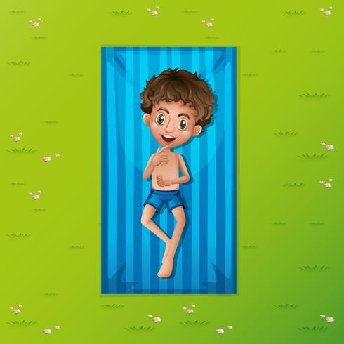 Un jeune homme reposant sur un tapis vecteur