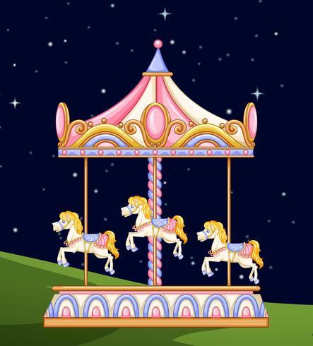 Un carrousel dans le parc la nuit vecteur