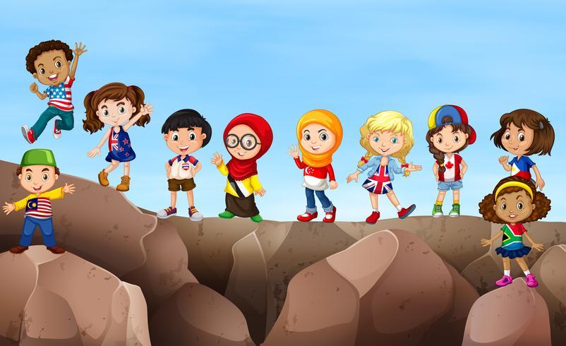 Enfants debout sur la falaise vecteur