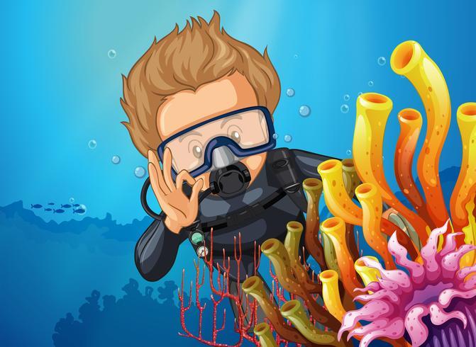 Plongeur sous-marin derrière la barrière de corail vecteur