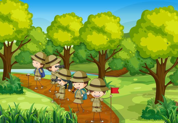 Scène d'enfants explorant la forêt vecteur
