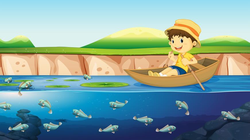 Un garçon sur un bateau en rivière vecteur