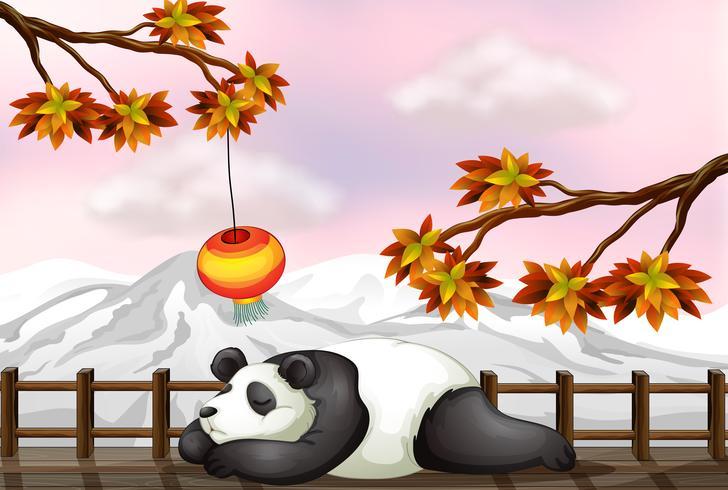Un ours endormi et une montagne de neige vecteur