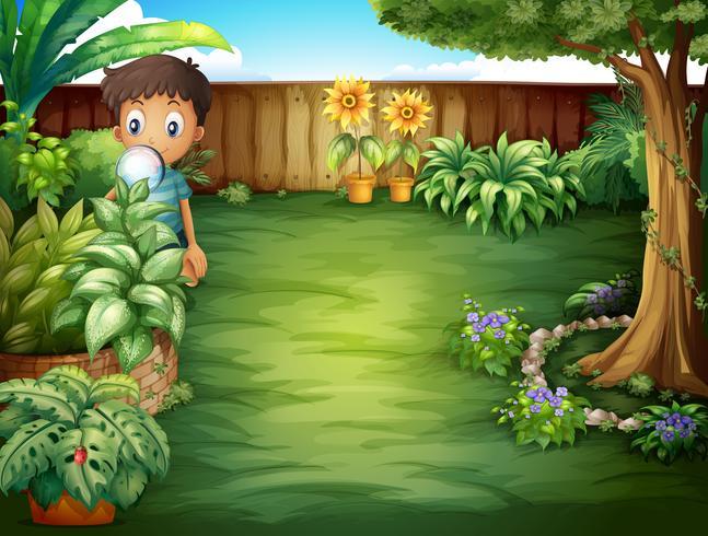 Un garçon tenant une loupe vecteur
