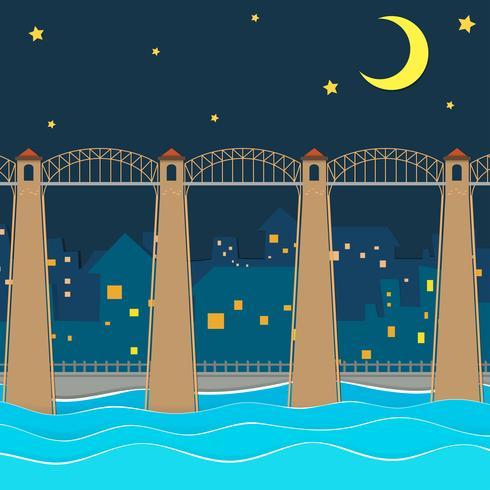 Pont sur la ville la nuit vecteur