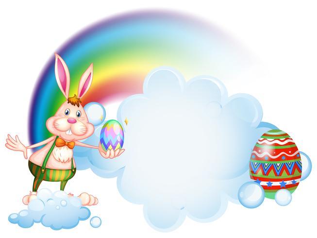 Un lapin tenant un oeuf près de l'arc-en-ciel vecteur