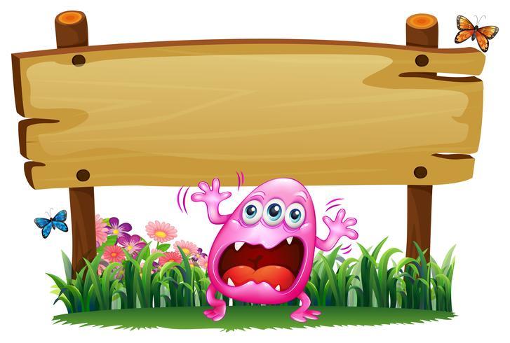 Un monstre rose effrayé sous l'enseigne en bois vecteur