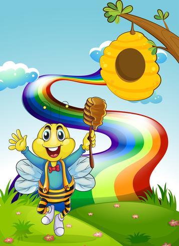 Une abeille heureuse au sommet d'une colline avec un arc-en-ciel vecteur