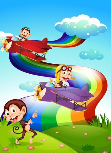 Un ciel avec un arc en ciel et des avions avec des singes vecteur