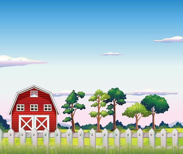 Une grange rouge à l'intérieur de la clôture vecteur