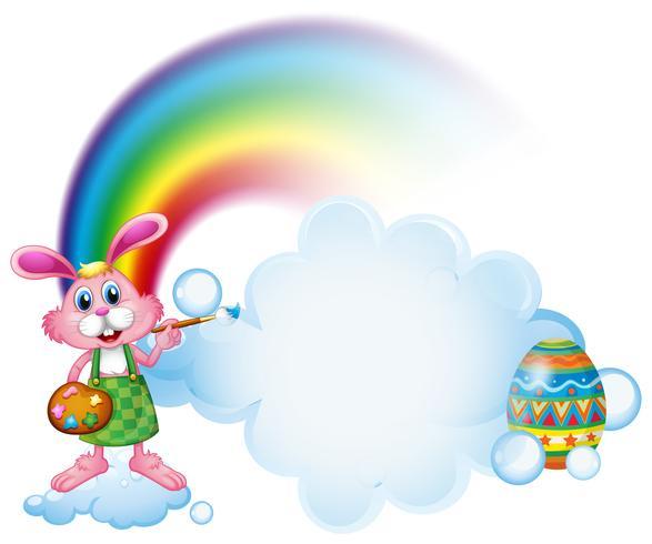 Un lapin en train de peindre près de l'arc-en-ciel vecteur