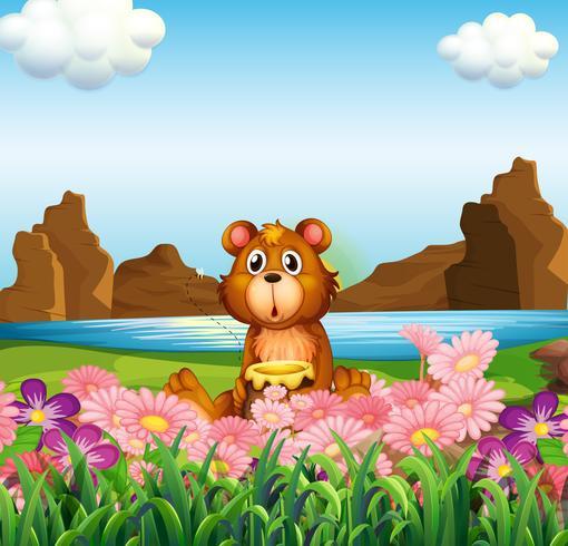 Un ours mignon près des fleurs au bord de la rivière vecteur