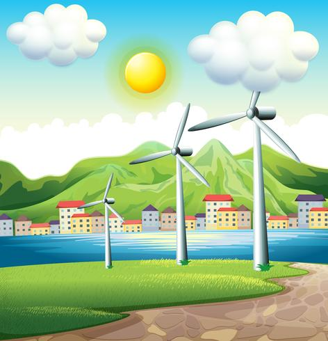 Trois moulins à vent à travers le village vecteur