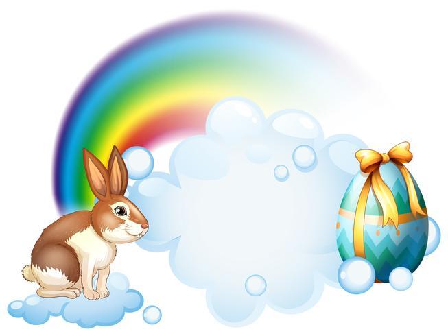 Un lapin et un oeuf près de l'arc-en-ciel vecteur