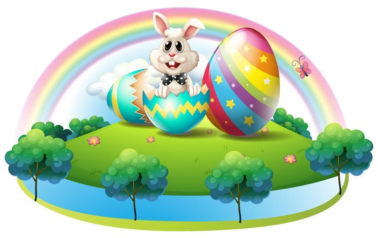 Un lapin dans l'œuf de Pâques vecteur